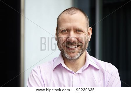 Portrait Of Cheerful Middle-aged Man