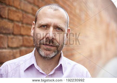 Man Against A Brick Wall