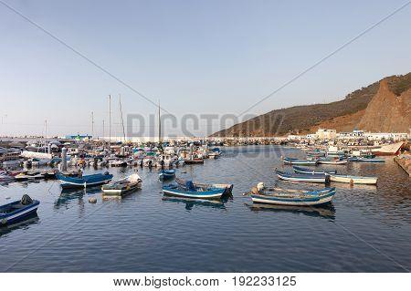Mdiq, Morocco - July 02, 2016: Blue wooden fishing boats in port