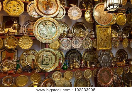 Street shop with traditional plates in Marrakech Morocco at night