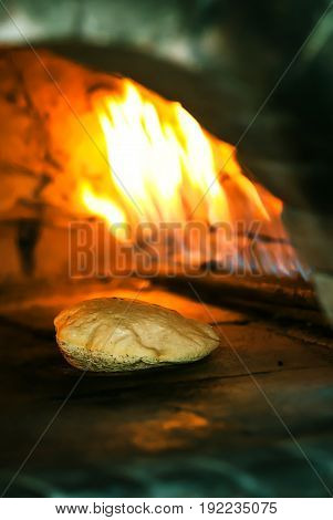 Fresh round pita is backing in the oven. Prepatation of tradition arabic bread