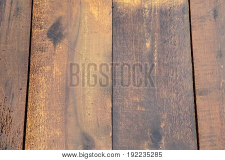 Natural hardwood Board is wet after rain. Background of wood brown. The texture of the wet wood.