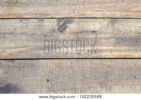 Board wooden natural planed wet. Background of wood brown. The texture of the wet wood.