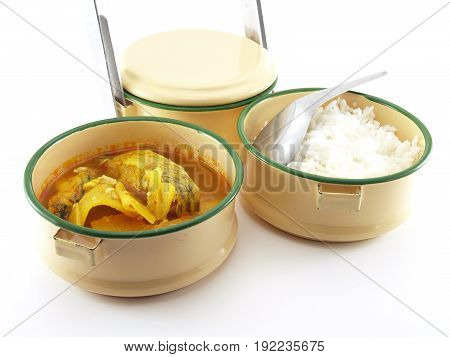 Thai food in food carrier isolated on white background, culture of eating in the past of Thailand, container in which to carry a packed meal in thai or asian style