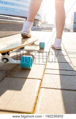 Girl With Wooden Longboard Skateboard.
