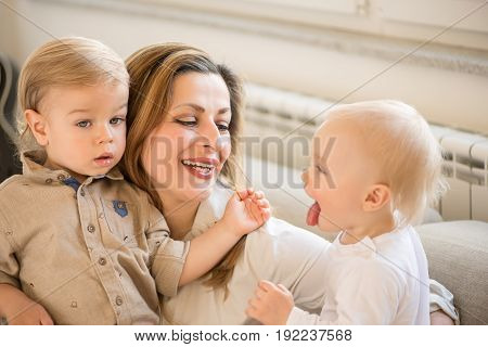 Portrait Of Beautiful Mother And Her Children. Family Values.