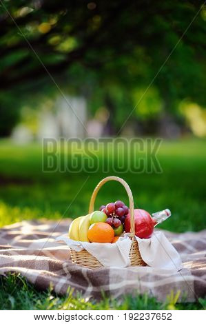Picnic Basket With Fruits, Food And Water In The Glass Bottle