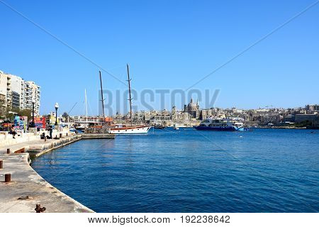 SLIEMA, MALTA - MARCH 30, 2017 - View across the Grand Harbour towards Valletta with Sliema waterfront to the left hand side Sliema Malta Europe, March 30, 2017.