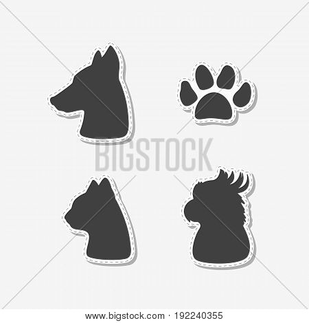Set of hand drawn stickers with heads of dog, cat, parrot and paw print. Templates for design or brand identity. Vector illustration
