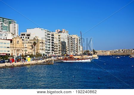 SLIEMA, MALTA - MARCH 30, 2017 - View along with waterfront with the Parish church of Jesus of Nazareth to the left Sliema Malta Europe, March 30, 2017.