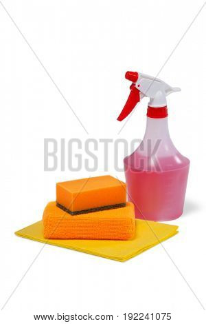 Detergent spray bottle, scouring pad and cleaning pad arranged on white background