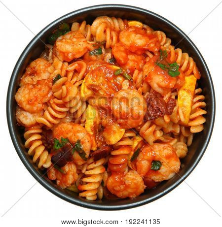 Shrimp and Fusilli Pasta with Summer Squash and Olives in round black bowl over white.