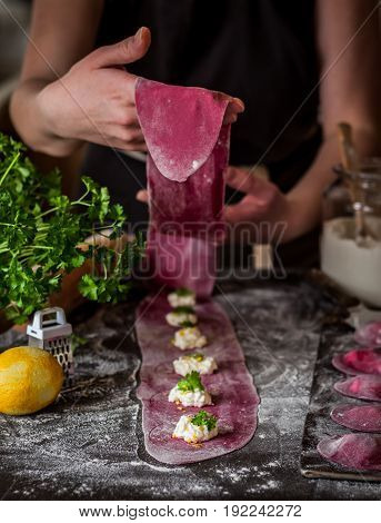 Female Making Beet Ravioli With Cheese