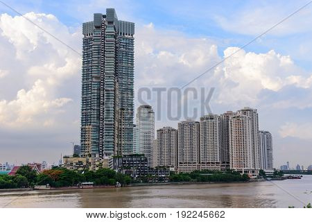 high building at the river and cloud on background