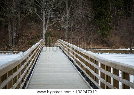A Beautiful Wooden Bridge Over The Frozen River