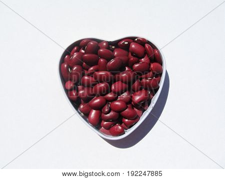 Grains of red beans. The isolated haricot on a white background.