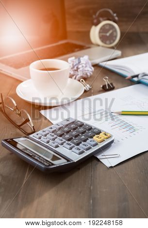 Calculator And Hot Coffee With Computer Notebook