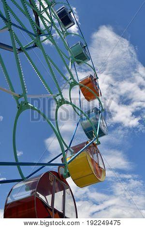Ferris Wheel In The Summer Park.