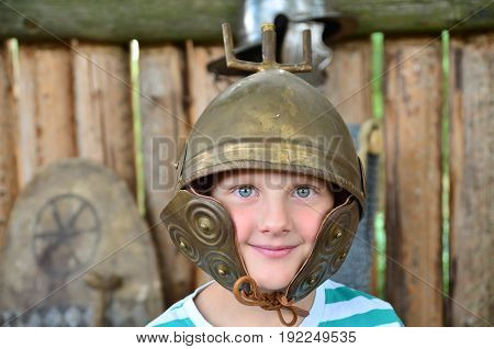 A young celtic warrior in cooper helmet