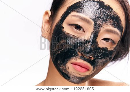 Black cosmetic face mask, beauty, health, asian, girl on isolated background, girl on white background.