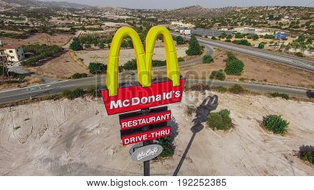 CYPRUS - JUNE 2016 - McDonalds sign near highway im Cyprus