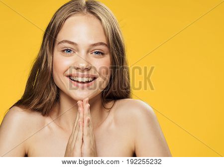 Girl on yellow background, young woman, portrait, woman smiling.