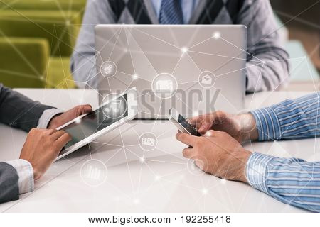 Close-up shot of white collar workers using devices while sitting at table in meeting room, collage