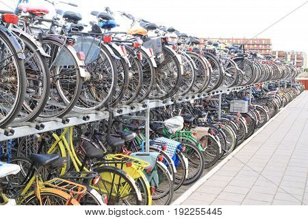 AMSTERDAM, NETHERLANDS - JUNE 19, 2014 : the bicycle parking station next to the Central railway station in Amsterdam, Netherlands