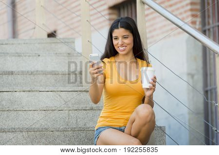 Attractive Latin Woman Texting On Her Smart Phone
