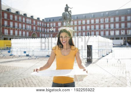 Attractive Latin Woman Looking At A Map