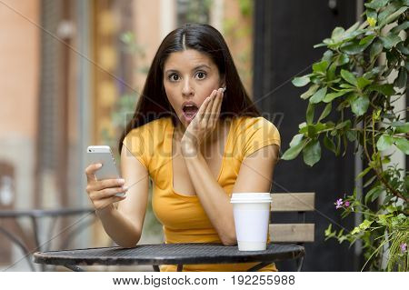 Attractive Latin Woman Shocked On Her Smart Phone