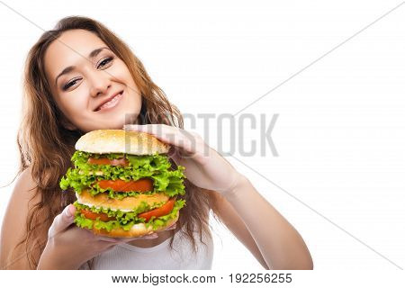 Happy Young Woman Eating big yummy Burger isolated on white background