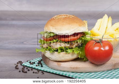 Homemade Budrger Chicken With French Fries, Tomato And Lettuce