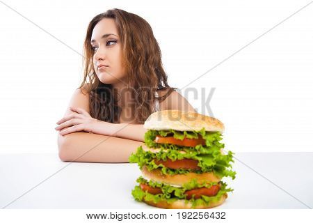 picture of healthy woman rejecting junk food isolated over white background