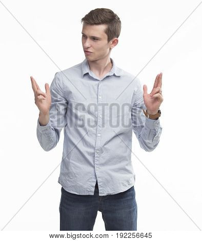Young sexy confident man showing presentation, pointing on placard on a gray background. Ideal for banners, registration forms, presentation, landings, presenting concept.