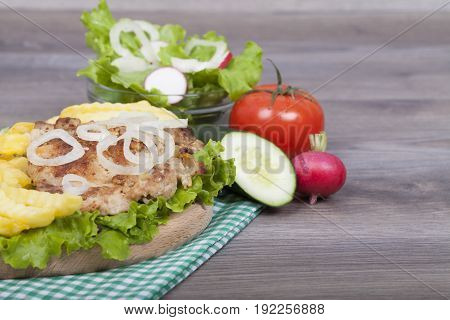 Preparing Very Tasty Homemade Chicken Burger With Fries