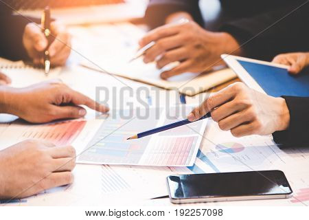Business partners discussing graph of financial business concept. Business Concept. select focus