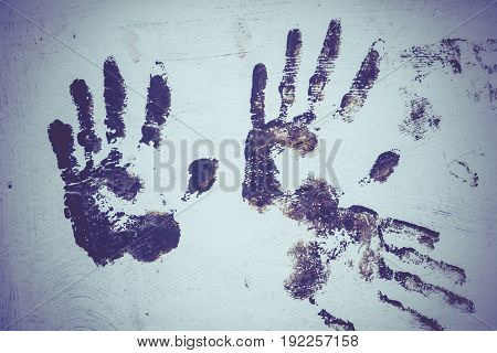 Brown Handprint On White