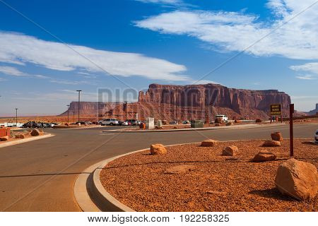 Utah USA - July 7 2011: Parking place and Peaks of rock formations in the Navajo Park of Monument Valley Utah
