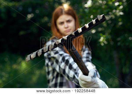 Rake, girl holding rake, garden, summer, gardener, gloves.