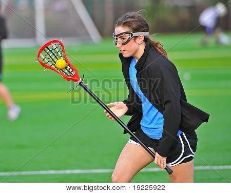 Lacrosse girl cradling the ball