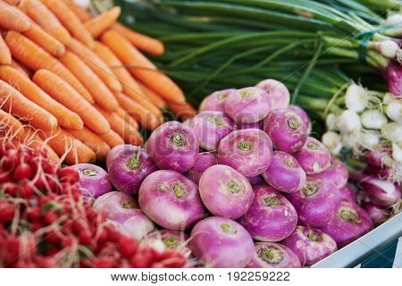 Turnips And Carrots On Farmer Market In Paris, France
