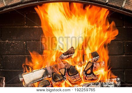 Burning firewood in the fireplace close up. fire burning charcoal background barbeque grill