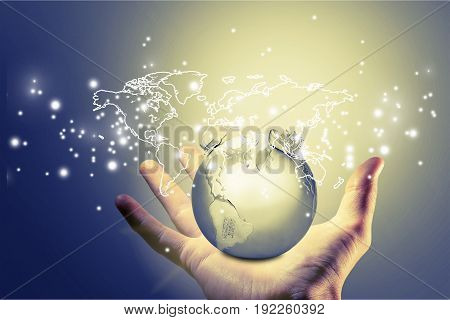 Holding hand world map sphere crystal glass