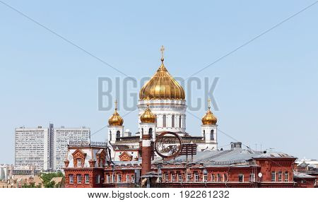 Moscow, Russia - May 15, 2016: Cathedral of Christ the Savior house on the New Arbat and confectionery manufacturer