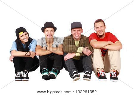 Group of friends sitting on white background