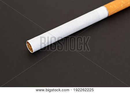 Closeup of a cigarette on dark background
