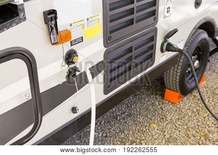 Filling The Water Tank Of A Campervan
