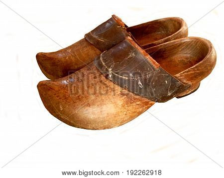 Pair of vintage clogs with leather strap isolated on a white background