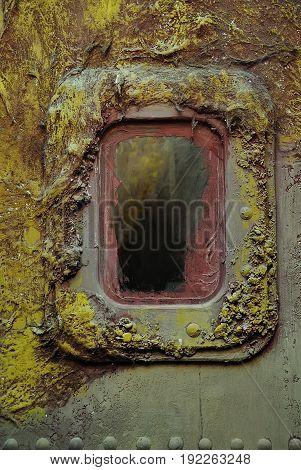 Illuminator on a rusty metal wall. Steampunk style